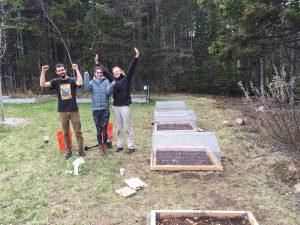 three students celebrating outdoors
