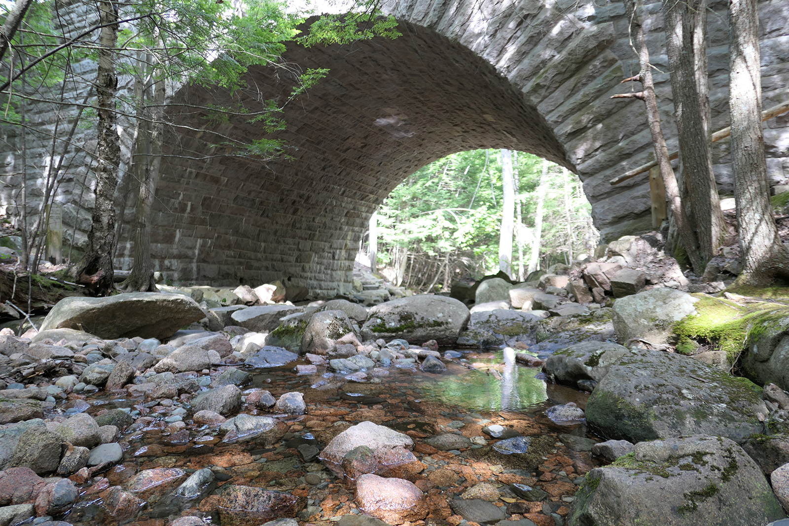 photo of stone bridge over stream