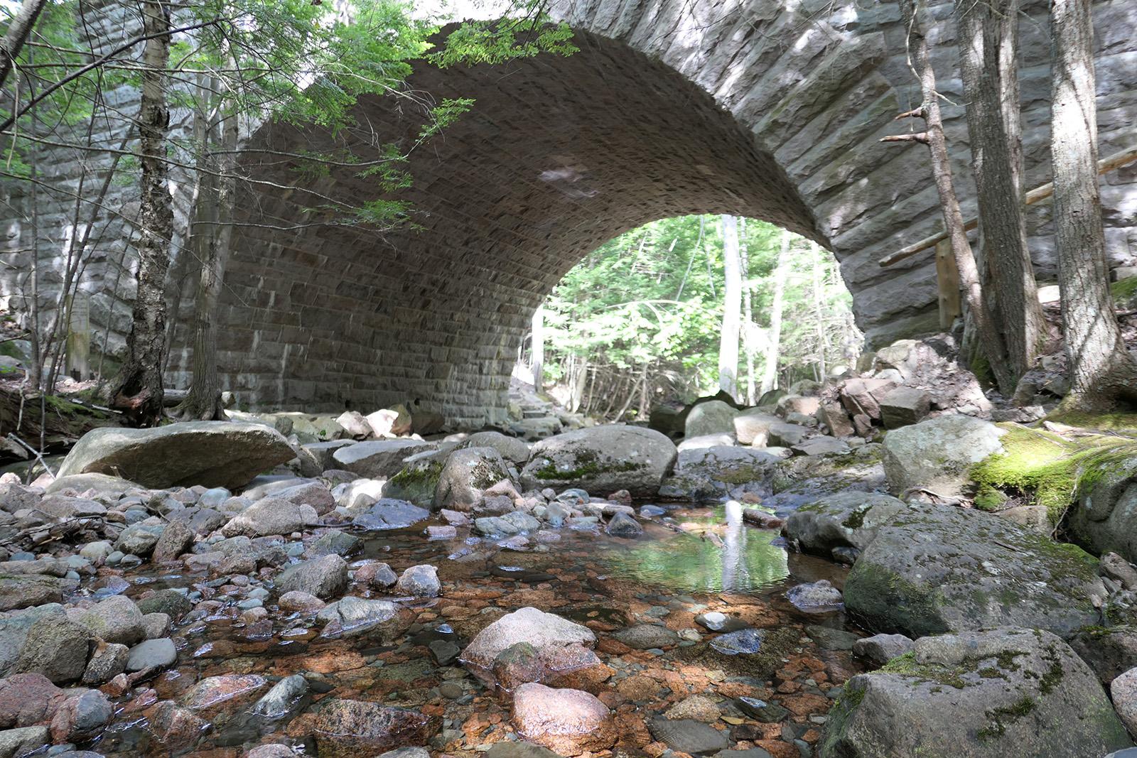 photo of stone bridge over stream