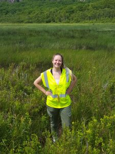 scientist sara McBride standing out in field