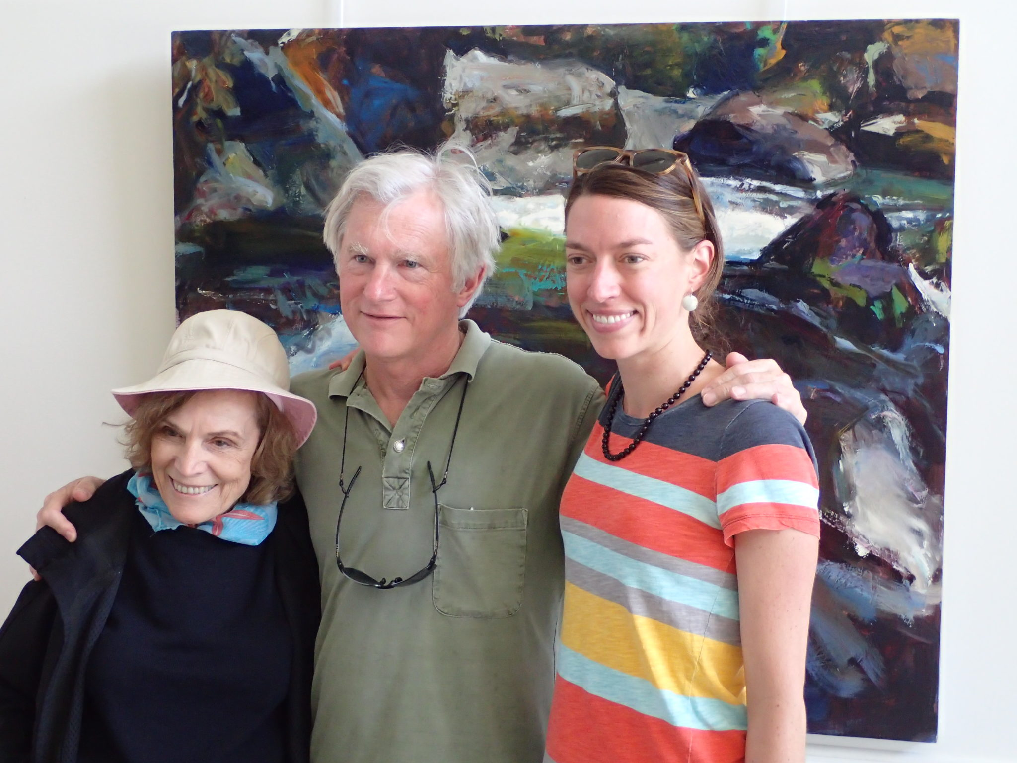 photo of Abbey Paulson and a couple standing in front of painting