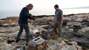 photo of scientists studying rock pools