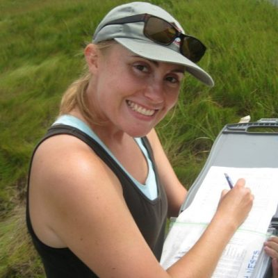 Kate Ruskin holding clipboard with grass in background